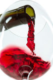 The red wine jet. With glass and bottle close up royalty free stock photos