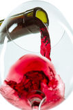 The red wine jet. With glass and bottle close up royalty free stock image