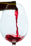 The red wine jet. With glass and bottle close up royalty free stock photography