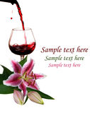 Red wine with  Lilies Royalty Free Stock Photo