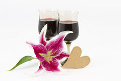 Red wine, lily, and heart Stock Photo