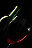 Red wine low key. Red wine and bottle against a black background Stock Photo