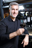 Red wine. Man drinking wine in a restaurant Royalty Free Stock Photography