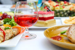 Red wine and many food Stock Photography