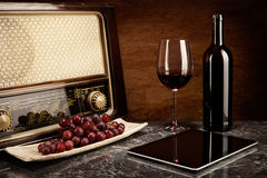 Red Wine, old and new Technology. Enjoying wine with old music and modern technology royalty free stock images