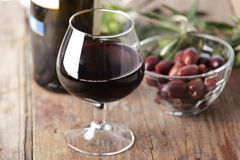 Red wine and olives Stock Images
