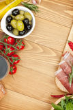 Red wine with olives, tomatoes, prosciutto, bread Royalty Free Stock Photo
