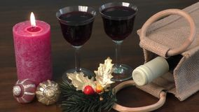 Red wine, ornaments and candles as a New Year decoration stock video