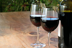 Red Wine on Outdoor Wooden Table Royalty Free Stock Image