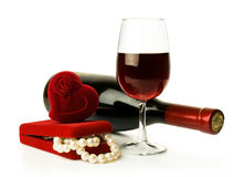 Red wine and pearl necklace Royalty Free Stock Photo