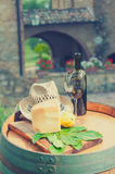 Red wine, pecorino cheese and pear, Italian snack in the Tuscan. Italian snack in the Tuscan countryside royalty free stock images