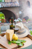 Red wine, pecorino cheese and pear on wood barrel. Red wine, pecorino cheese and pear, Italian snack in the Tuscan countryside stock photography