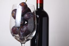 Red wine and plums Stock Photos