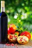 Red wine and pomegranates Royalty Free Stock Photos
