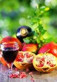 Red wine and pomegranates Stock Photo