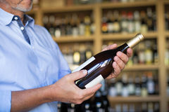 Red wine. Portrait of sommelier in wine store Royalty Free Stock Image