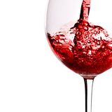 Red wine pour into glass. Isolated over white background Royalty Free Stock Photography