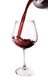 Red Wine Poured. Into a glass isolated on white background Stock Photography