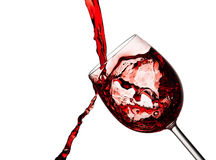 Red wine poured into crystal glass Royalty Free Stock Photo