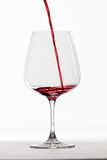 Red wine poured into glas Royalty Free Stock Photos