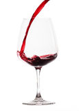Red wine poured into glas (white background) Stock Image