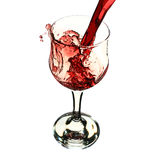 Red wine poured into glass Stock Photos