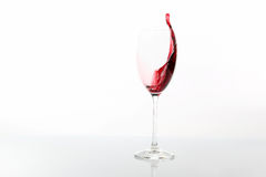 Red wine poured from a glass. The red wine poured from a glass Royalty Free Stock Photography