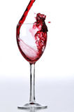 Red wine poured on glass Royalty Free Stock Photo