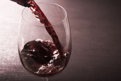 Red wine poured into a glass stock photo