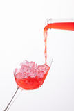 Red wine poured in a glass Royalty Free Stock Image