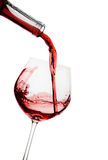 Red wine poured in a glass Royalty Free Stock Photos