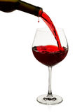 Red wine poured in a glass Stock Images