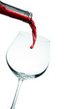 Red wine poured in a glass. Isolated on white Royalty Free Stock Images