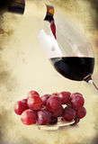 Red wine poured in a glass - retro style Royalty Free Stock Photography