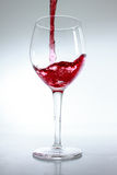 Red wine poured in a glass Stock Photos