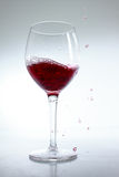 Red wine poured in a glass Stock Image