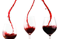 Red wine poured in glass Stock Photos