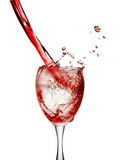 Red wine poured in a glass  on white background. A Stock Image