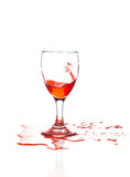 Red wine is poured into a glass. On a white background Stock Images