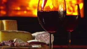 Red wine is poured into glasses stock video footage