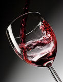Red Wine Poured Into Glass Stock Photography