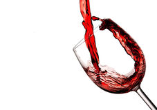Red wine poured into a wine glass. Red wine poured into a crystal wine glass to make a splash Stock Photography