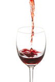 Red wine poured in a wine glass Royalty Free Stock Image