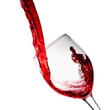 Red wine poured into wine glass Stock Photo