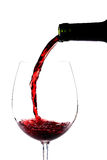 Red wine pouring Stock Photography