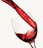 Red wine pouring. Glass. Blends - only effect Royalty Free Stock Photos