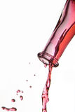 Red wine pouring from bottle Stock Photo