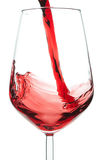 Red wine pouring into a crystal glass. Royalty Free Stock Photography
