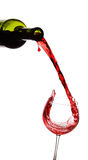 Red wine pouring down from a bottle Stock Images