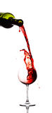 Red wine pouring down from a w Stock Photography